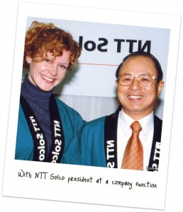 With the president of NTT Solco at the company's re-naming ceremony, 1999